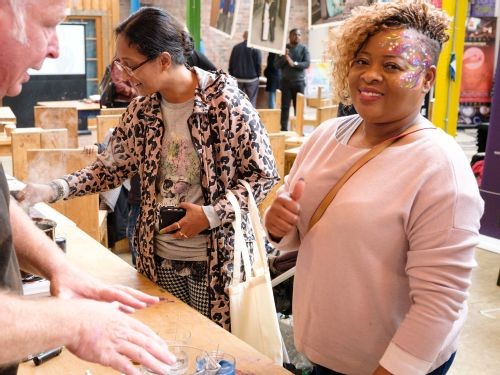Visitors enjoy talking to researchers and having their faces painted