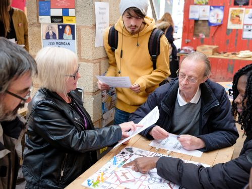 Visitors explore the 'Homeless Monopoly' board game project