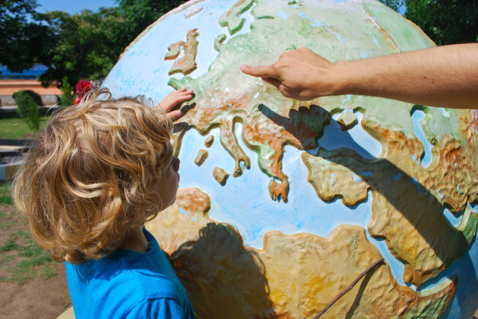 A child plays with a globe