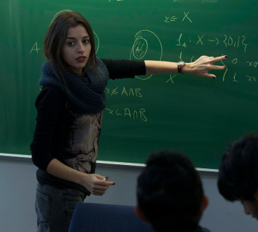 Student working on theory on blackboard