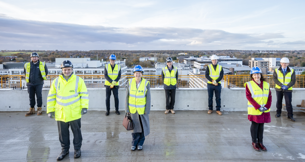 Representatives from Warwick, Bowmer + Kirkland and Feilden Clegg Bradley are seen on the very top of the new Arts Building