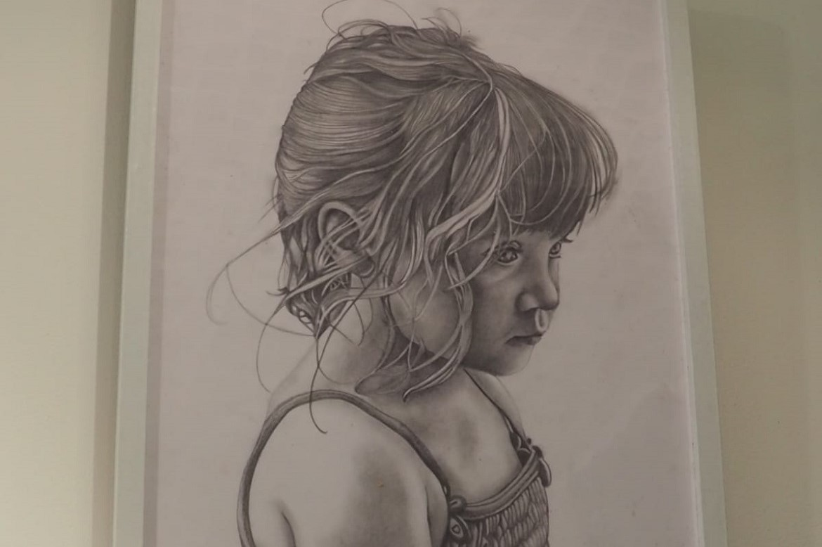 Artwork by Hannah Booth, titled 'Little child', featuring a young girl whose 'innocence is lost, her face is sunken and filled with tears'