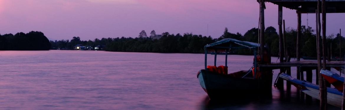 A boat at sunset in Cambodia