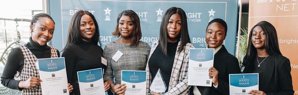 Members of the executive team of the Black Women's Project collecting their awards at the event