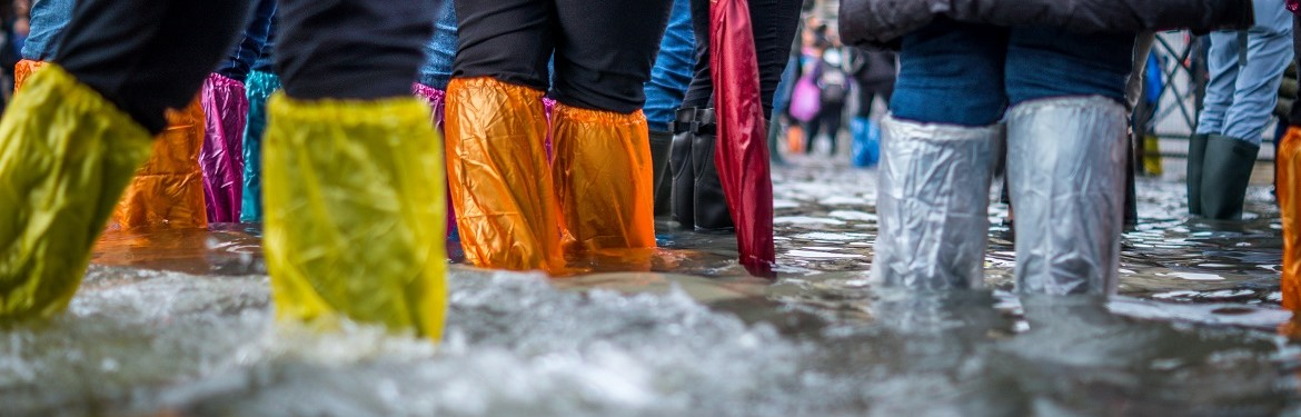 Tourists try to stay dry in a flooded St Mark's Sq, venice