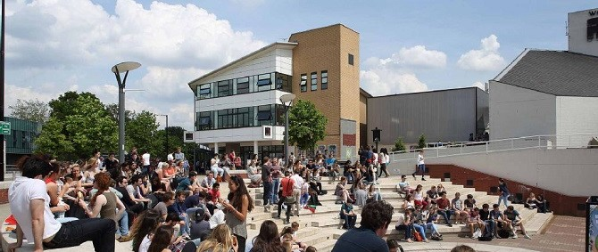 Students gathered on the piazza on a sunny day