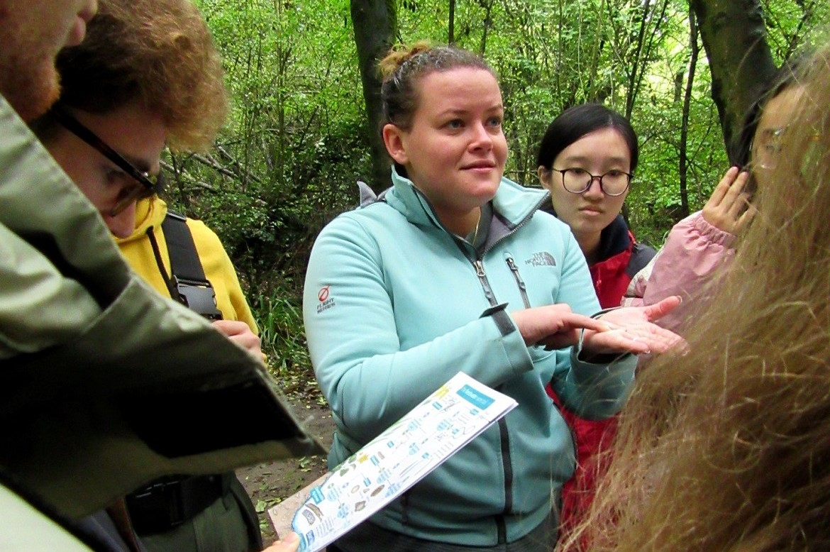 Dr Jess Savage teaching a group of GD109 students in Tocil Woods