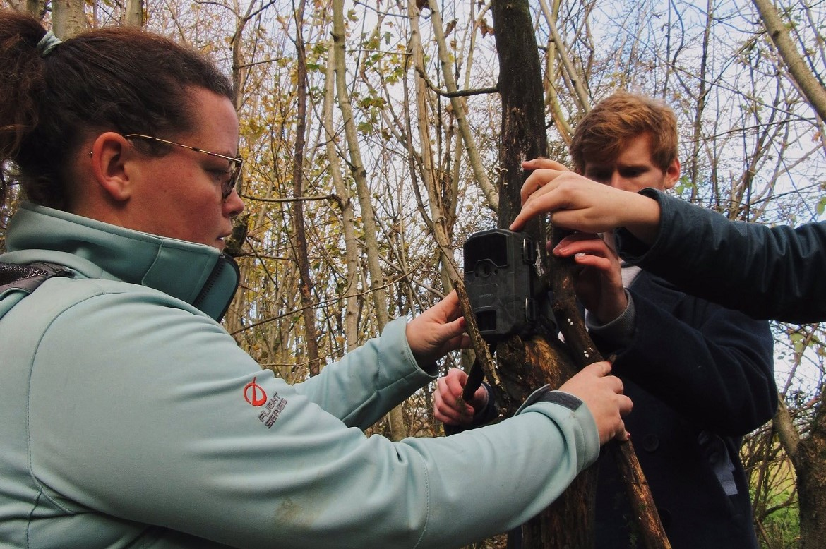 GD109 students and Dr Jess Savage setting up a camera to capture wildlife on campus
