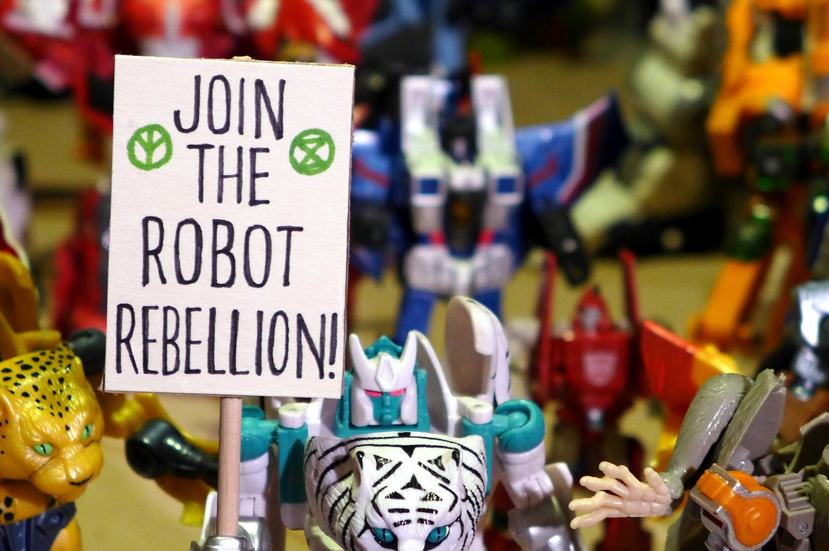 Protest signs made by visitors of the CHANGE Festival, this one is held by a robot