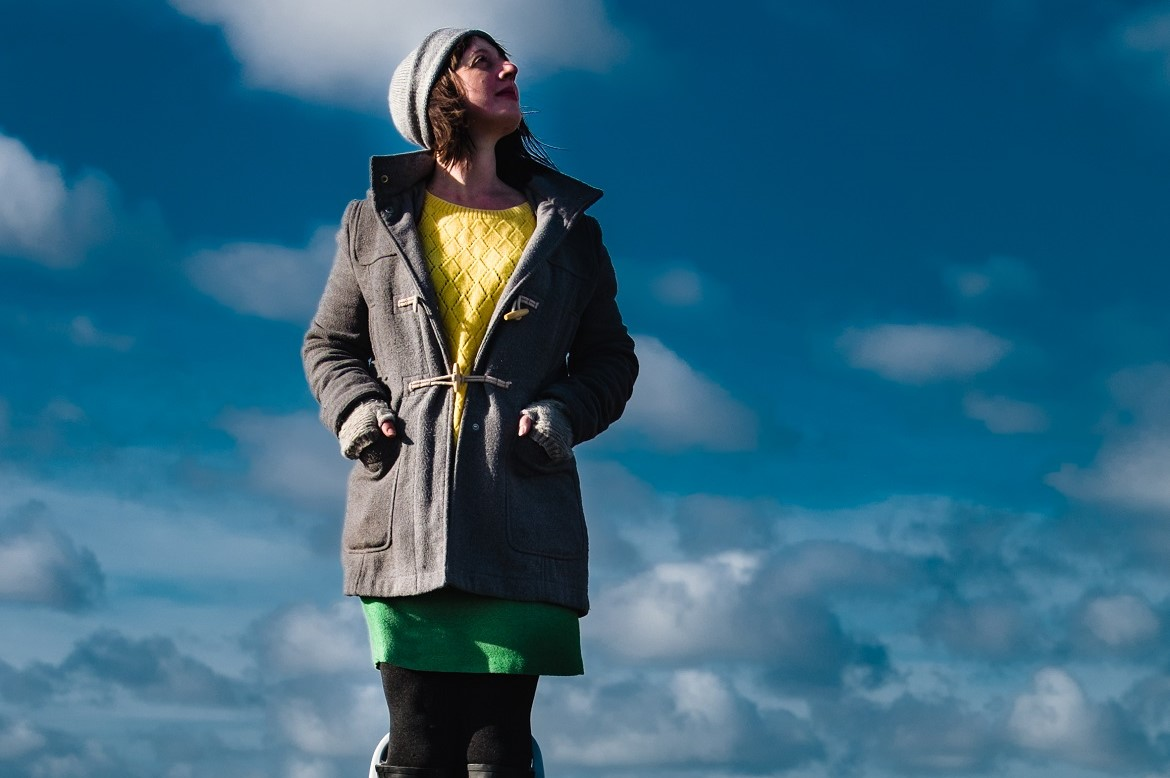 Woman looking up at the sky, part of the festival's advertising