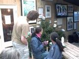 Jon, Daisy and Sarah watch the looping DVD at Heligan that gave a flavour of how the production would have looked at Eden.