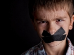 Boy with black tape over his mouth