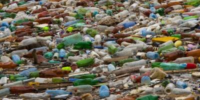 Plastic bottles floating on sea