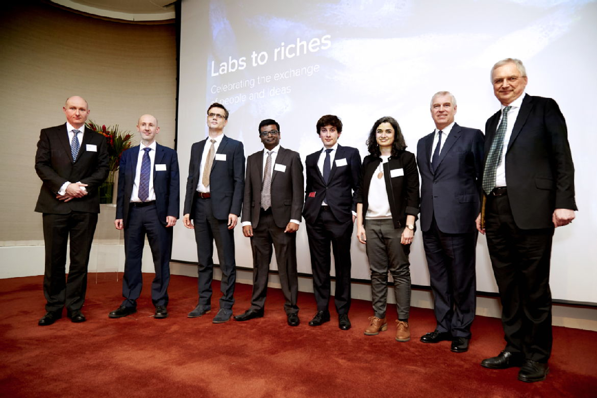 Photo (© The Royal Society): The Royal Society Industry Fellows 2018 (Round 1): from left to right Duncan Maclachlan, Steve Morgan, Del Atkinson, Gihan Mudalige, Anas Al Rawi, and Aurora Cruz-Cabeza, with HRH Prince Andrew, The Duke of York and Prof. Andrew Hopper, Labs to Riches presentation event, 20 March 2018, at the Royal Society head office in London.