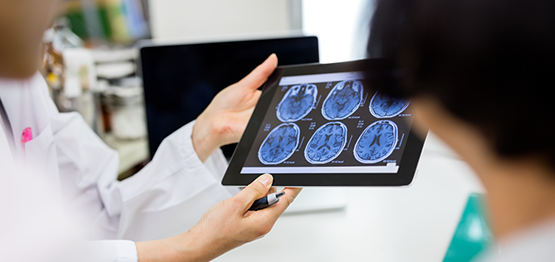 Applied Computing: People examining scans on mobile device in medical environment
