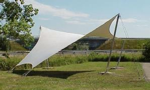 Free-form fabric enclosure erected in a field