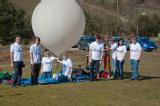 Team with balloon and CubeSat ready to launch