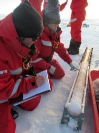 scientists taking ice cores on the MOSAiC expedition