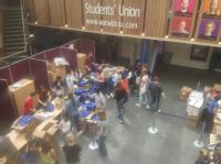 Volunteers sorting welcome packs