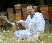 Dave Chandler with Beehives