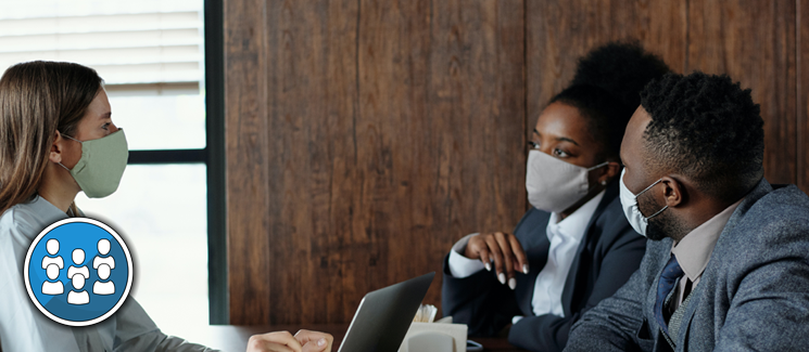 Public Health - meeting between three people in face masks