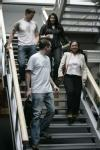 Postgraduate students on stairs