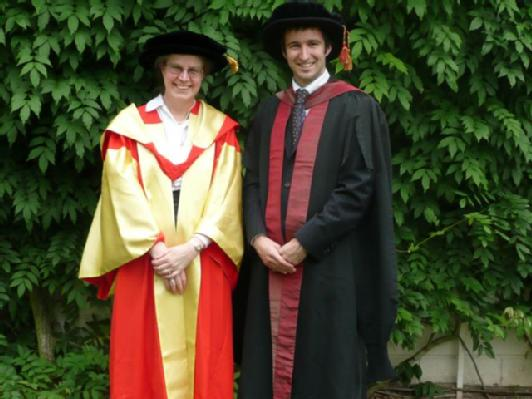 Adair graduating with Prof. Alison Rodger