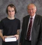 Prize awarded by Professor Cooper to M. J. Whitfield for Best Overall Performance: MMathsPhys Graduating Class