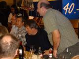 Left to right: Durba Sengupta (standing), Mark Wilson, Erich Muller; Peter Cummings and Roland Faller (standing) spot something on the table.