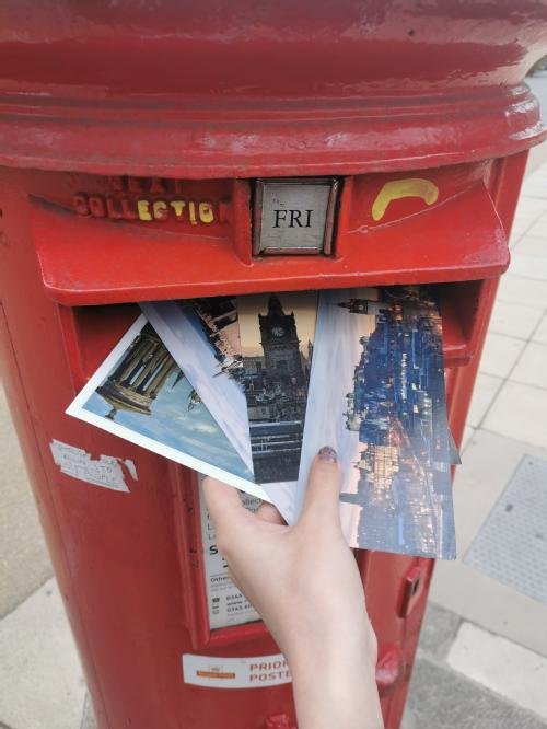 Postbox and postcards