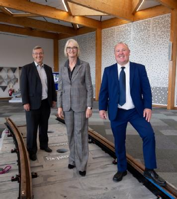 Pictured left to right: Stuart Croft (Vice Chancellor, University of Warwick) Margot James (Executive Chair, WMG), and Councillor Jim O'Boyle (Cabinet Member for Jobs, Regeneration and Climate Change, Coventry City Council), stand on the new Coventry VLR track form.