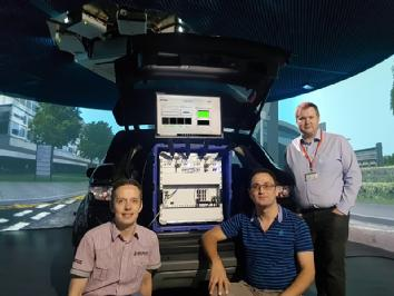Dr Erik Kampert, Mr Karen Vardanyan and Dr Matthew Higgins install and commission the 5G NR Test UE inside WMG's 3xD Simulator