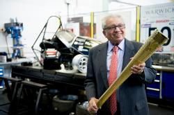 Professor Lord Bhattacharyya with Olympic torch