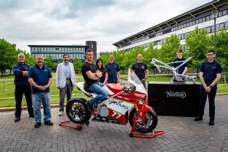 The finished electric racing bike next to a model of the Norton Motorcycles frame it is built on. The full team from left to right are: Robert Driver – Battery Testing & Characterisation Engineer, David Cooper – Precision Engineer at WMG, Professor Dave Greenwood - CEO of WMG High Value Manufacturing Catapult, Tom Weeden – the professional rider for the team, Lee-Rose Jordan – Project Manager, Student Projects at WMG, Malcolm Swain – Lead Engineer a WMG, Martin Neczaj – Chief Chassis Engineer at Norton Motorcycles, James Grohmann –Lead Design Engineer (Student), Aman Surana – Chief Engineer of Warwick Moto team (Student)
