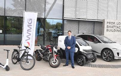 Professor Dave Greenwood with a series of micro-mobility vehicles outside the National Automotive Innovation Centre.