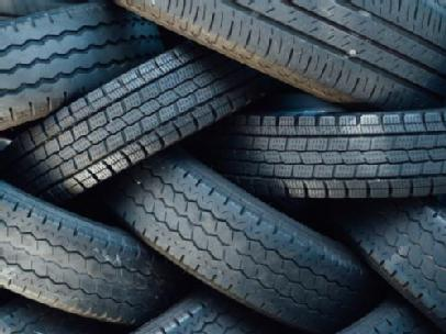 Group of car tyres clustered together.