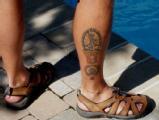 Rob Kent: Rob's tattoos mark a series of endurance sport achievements.
