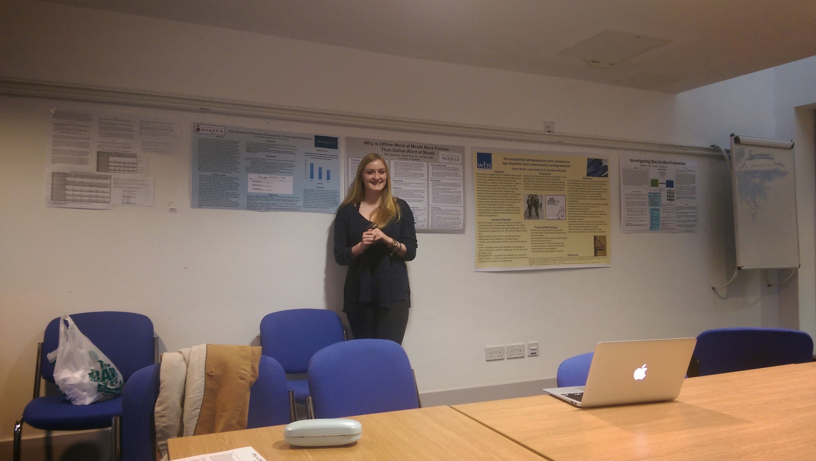 Undergraduate researcher with poster