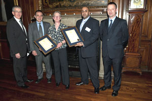 Harry and Joan receiving their awards from the Chairman of AUCSO and the Acting Vice Chancellor of City University
