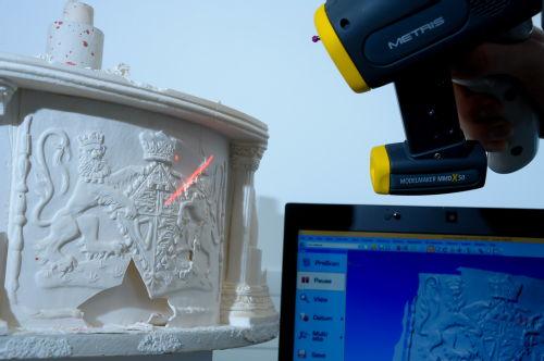 WMG experts scanning the Queen's wedding cake