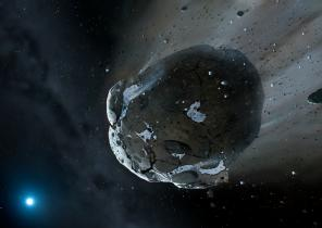 Artist's impression of a rocky and water-rich asteroid being torn apart by the strong gravity of the white dwarf star. Similar objects in the Solar System likely delivered the bulk of water on Earth and represent the building blocks of the terrestrial planets. Image copyright Mark A. Garlick, space-art.co.uk, University of Warwick