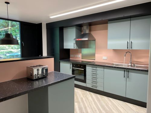 Modern kitchen showing oven, toaster and plentiful cupboard space