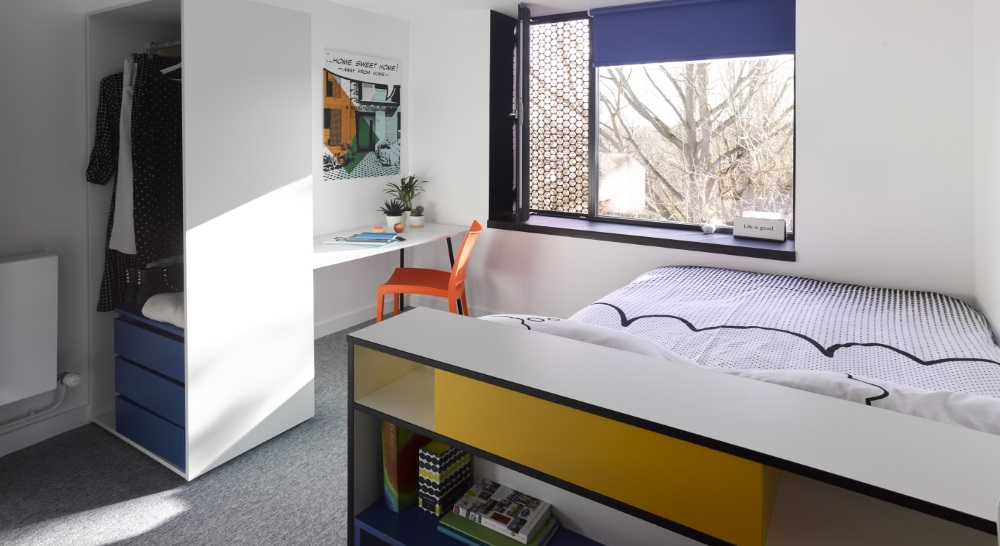 Modern bedroom with bed, storage space, wardrobe and window