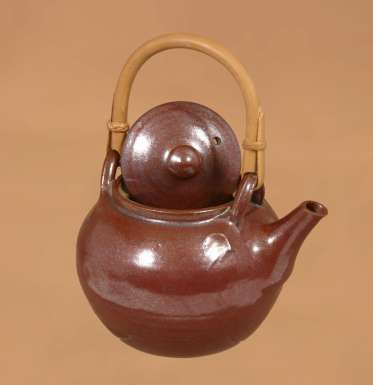 Teapot with cane handle by Winchcombe Pottery