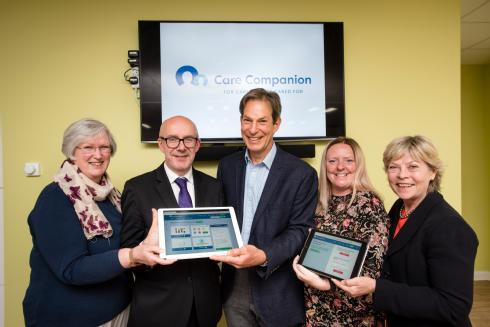 The University of Warwick's launch of Care Companion, an online platform for carers in Coventry and Warwickshire (from left): Gillian Grason Smith (Chair of the Carers' Panel), Matt Western MP, Professor Jeremy Dale (Project Leader), Amanda Cogley (Commissioning Support Officer for Warwickshire County Council) and Cllr Izzi Secombe (Leader of Warwickshire County Council). Credit: University of Warwick/Katie Neeves