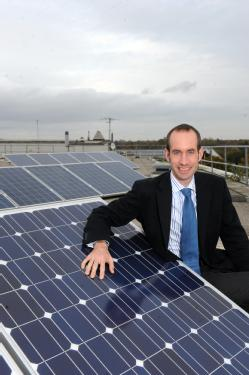 Dr Stan Shire with the New World Solar panels