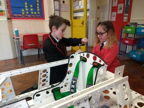 Children from St Mary's building the car