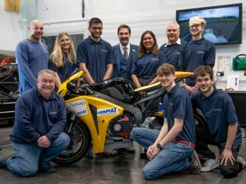 The students and some academics working on the Warwick Moto team with the bike.