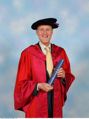 Sir Peter Bazalgette receiving his Honorary Doctor of Letters from the University of Warwick
