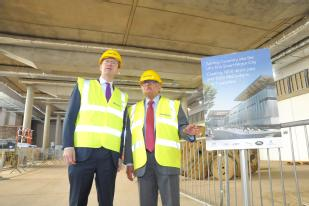 Secretary of state Greg Clark MP and Professor Lord Bhattacharyya (WMG, University of Warwick) see construction work at  the National Automotive Innovation Centre 2017